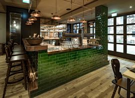 "The green tiled bar in our restaurant ""Ayinger in der Au"" in Munich city centre."