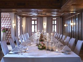 One of Platzl event's room for private celebrations, with a big table festively decorated