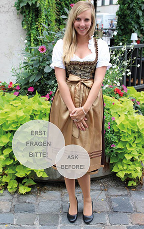 "Lady wearing a Dirndl with a bow in the center, which traditionally means ""Don't touch"" for Oktoberfest guests."